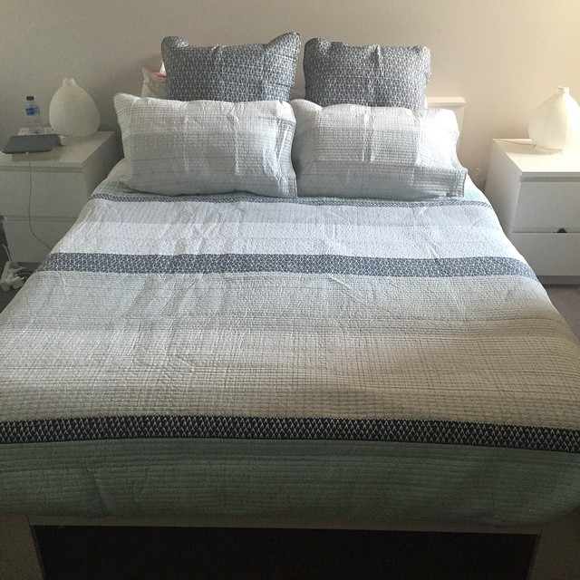 Bought myself a new bedspread & I'm very happy with how it looks on! Just need a real cushion or two to add a little colour! (just ignore the mess on the bedside table!) @adairs #myhome #newthings